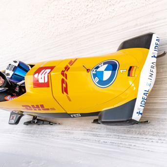 Alexander Schüller im Bob von Friedrich auf Platz 1 in Innsbruck-Igls